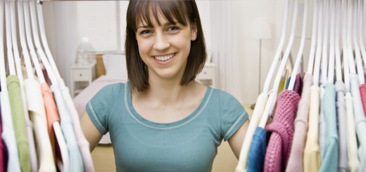 Curious teenager searching in closet for something to wear